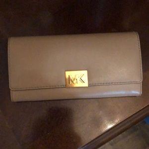 Beige & gold Michael Kors wallet.